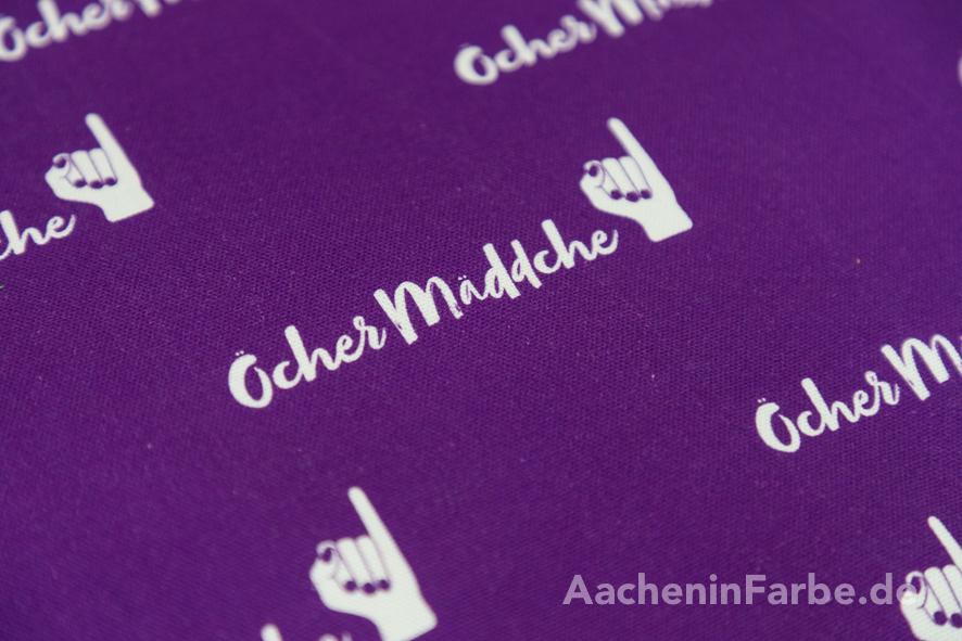"""Stoff """"Öcher Mäddche"""", Klenkes, lila-weiß (0,5 m)"""